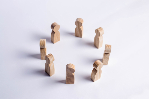 Circle of wooden figures